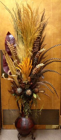 #Pheasant #feather with #dried flower in metal vase. Designed by Arcadia Floral & Home Decor