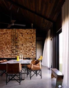 Dining: Hill Plain House in Metcalf, Victoria, by Australian firm Wolveridge Associates wood partition leather chairs (photo: Derek Swalwell). Interior Architecture, Interior And Exterior, Interior Design, Kitchen Interior, Wood Partition, Log Wall, Contemporary Barn, Turbulence Deco, Wood Logs