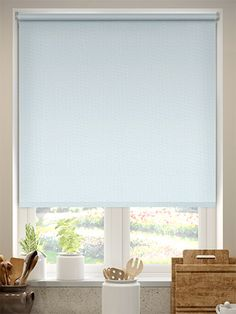 Here the colour of the Summer Sky roller blind is light pastel blue, perfect for a bathroom accessorised with touches of blue, or great in a kitchen that needs a little touch of colour at the window.