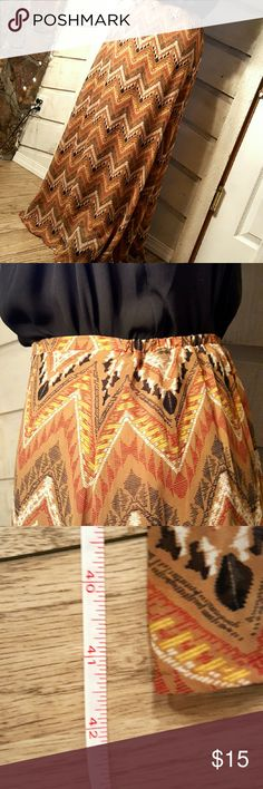 """NWT Tribal Maxi Skirt Small Brand new skirt with tag. Tribal pattern perfect to wear for spring or summer. Chiffon style skirt but has lining so no need to wear a slip. Second photo is side view of skirt, you can see the front side has a non elastic waist band and the back side does have the elastic. Size small but can fit up to a size medium (that's my size). Total length is about 41 inches. I'm 5'1"""" and it fits me long. Daniel Rainn Skirts Maxi"""