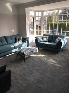 Our living room. French Connection Zinc sofas, Valspar Lip Gloss paint