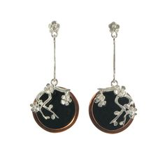 Drop earrings featuring silver blossoms set on resin with a copper surround and pearls.