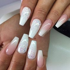 Idon't normally like long nails like this but these are cute. Would make nice weddig nails