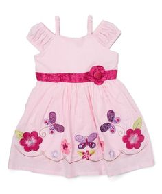 Little darlings will feel lovely in this sweet dress adored with a ruffled top and embroidered skirt.