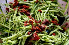 Zucchini Noodles with pesto and sundried tomatoes...  YUM!!! great way to use up zucchini & tomatoes