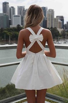 The dress is cute, but I just want to be that tan...