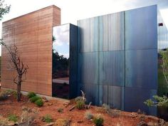 Rammed earth, glass & steel. Gorgeous combination of material and texture.