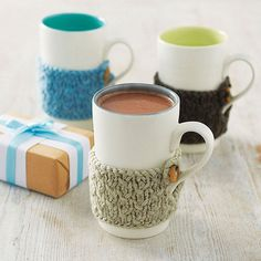 Hand Knitted Cosy Mug by Linda Bloomfield, the perfect gift for Explore more unique gifts in our curated marketplace. Tricot Simple, Diy Cadeau Noel, Mug Cozy, Porcelain Mugs, Yarn Bombing, Hand Knitting, Knitting Ideas, Knitting Projects, Colorful Interiors
