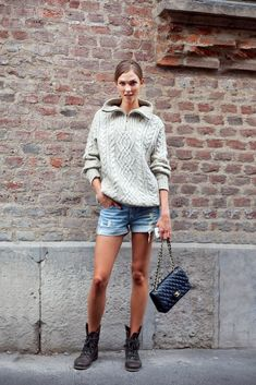 Cut off denim shorts with a cable knit sweater (sleeves rolled up) for a an easy seasonal transitory outfit for fashion week from summer to fall.