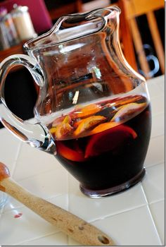 The Best Sangria Ever: 1 bottle merlot (can use cabernet or zinfandel)  1 lemon, cut into wedges  1 orange, cut into wedges  2-3 Tablespoons sugar  2 shots rum  2 cups Club Soda (could use Ginger Ale)  Other fruit: strawberries, blueberries, kiwi, peaches, raspberries