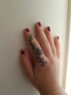 Delicate floral finger tattoo