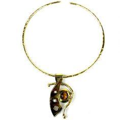 Uniquepedia.com - Unique Shine Golden Tiger Eye Domino Pendant Necklace, $75.00 (http://www.uniquepedia.com/unique-shine-golden-tiger-eye-domino-pendant-necklace/)