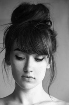 Messy bun updo for medium hair. Medium hairstyle with bangs. Updo hair for women.