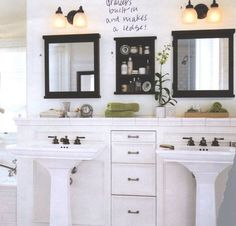 Ledge above the double pedestal sinks and recessed drawers.