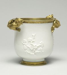 Bowl with Flowering Prunus. Porcelain: 1720-1730; Mounts: mid 18th century. Porcelain with glaze, design in applied relief, and metal rim French mount. H: 4 7/16 in. (11.2 cm). Acquired by William T. or Henry Walters. 49.1729. The Walters Art Museum
