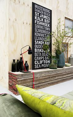 Make an elongated rack from new or used plank boards. Make two adjacent stacks and attach them with straps. If you want to add colour, paint the ends of the boards in the same colour as the strap.