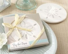 By the Shore Sand Dollar Beach Coaster Favor (Kate Aspen 23041NA) | Buy at Wedding Favors Unlimited (http://www.weddingfavorsunlimited.com/by_the_shore_sand_dollar_coaster.html).