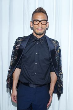 Hidetoshi Nakata wearing Louis Vuitton Fall/Winter 2013-14 at the 'Timeless Muses' exhibition opening event in Tokyo.