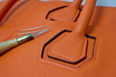 Inset handle and stitching details