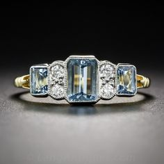 Aquamarine and Diamond Vintage Style Ring; A trio of bright and beautiful, deep pastel-blue emerald-cut aquamarines, together weighing 1.37 carats, alternate with pairs of bright-white sparkling diamonds in this sleek and stunning ring, crafted in London, England in homage to 1930s vintage Art Deco style.