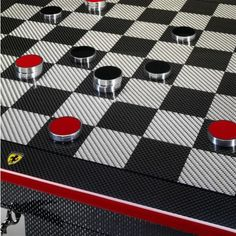 Ferrari Carbon Fibre Chess Set - Features the enamelled metal Ferrari shield on the front.The playing board has alternates squares in carbon fibre and fibreglass.The chess pieces inside are made from black and red varnished wood.The knight piece is inspired by the Prancing Horse. http://store.ferrari.com/gb_en/home-office/collectibles/desk-items/ferrari-carbon-fibre-chess-set.html
