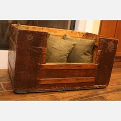 Dog Bed made from an old trunk. Love the idea.  Price @ $250 is ridiculous.  If I could find an old trunk, pretty sure we could make something pretty close.  Need to look in! thrift stores.  Heck top doesn't even need to be there