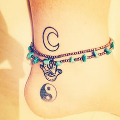 Moon Hamsa Yin Yang tattoo on ankle with boho anklets
