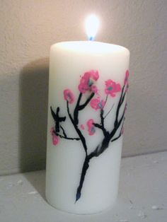 Painting with melted crayons to make plain old candles not-so-plain anymore ;)
