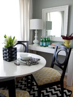 Glamorous on a Dime  Britany used her DIY skills to create this chic dining area on a budget. She designed and built this white Parsons-style table for extra countertop space and recovered the homeowner's existing dining chairs with a fun trellis pattern.