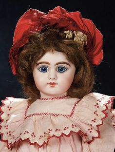 """19"""" German bisque child by Simon and Halbig, circa 1888, marked 749 dep 8. Paperweight eyes. Wears antique dress."""