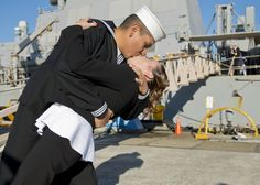 Fire Controlman 2nd Class John Bejarano, assigned to the Arleigh Burke-class guided-missile destroyer USS Stethem (DDG 63), kisses his wife after returning home after an eight month deployment. Stethem is assigned to Destroyer Squadron (DESRON) 15 and forward-deployed to Yokosuka, Japan. (U.S. Navy photo by Mass Communication Specialist 3rd Class Gregory A. Harden II/Released)