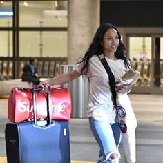 Karrueche Tran is all smiles as she is seen arriving at LAX Airport