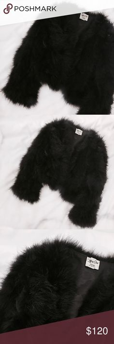"""FP Vintage Marabou Feather Crop Coat Black crop jacket in a luxurious marabou feather purchased from the in-store vintage section at Free People. The ultimate statement making piece to layer over turtlenecks, t-shirts, and slip dresses. Great vintage condition. Lightweight marabou feather construction. Original vintage brand is Jeffrey Davis evenings. Love this piece, only selling since I have another very similar one. Measures 20""""L and 21""""pit to pit, fits like a size S-M but is great for…"""