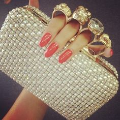would love to have a brass knuckle bling ring!!!! and it is cool as a purse handle as well.
