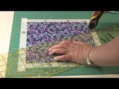 ▶ Template-Free Kaleidoscope Puzzle Quilts Part 1 - YouTube -- very clever technique using tape frame on cutting mat