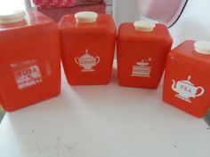 Set of 4 vintage red canisters lustro ware