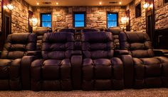 Putting a Spin on Traditional Home Entertainment The creative minds behind Theater Monster put their heads together to develop an inspired and unique home theater for the residents of this particular home. They wanted to design a rustic theater that their client would be proud to show to guests, so it was a must toRead More At Home Movie Theater, Home Theater Rooms, Home Theater Design, Cinema Room, Eldorado Stone, Leather Recliner, Home Movies, Stone Veneer, Home Entertainment