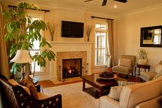 green and cream color storage in basement   Small living room with dark hardwood floors and fireplace with TV