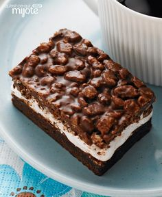 Delectably decadent chocolate, peanut butter, marshmallow creme and puffed rice combine in perfect harmony in these Nutty Chocolate Mallow Bars. Tap or click the photo for this Delicious Desserts, Dessert Recipes, Yummy Food, Tasty, Potluck Recipes, Decadent Chocolate, Chocolate Desserts, Rice Krispies, Puffed Rice