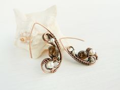 Smoky wings by UrsulaOT wire wrapped copper, Smoky Quartz and Pearls earrings. Via Deviant art.