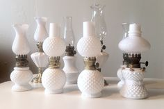 """milk glass mini oil lamps,   Nimble Well chicago vintage rentals  """"back row, 2nd from left...2.39"""" lvl"""