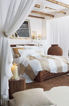 A relaxing bedroom in crisp white and linen bedding from Ralph Lauren Home