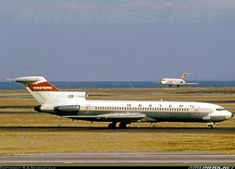 Western Airlines Boeing 727-247 @SFO, circa 1970.  A Hughes AirWest DC-9-30 landing in the background.