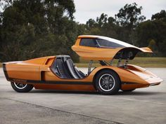 STRANGE SPORTS CARS - CHECK OUT THIS DOUBLE DOOR PLUS TOP CANOPY THAT OPENS UP AS ONE WHOLE UNIT! - JUMP IN.