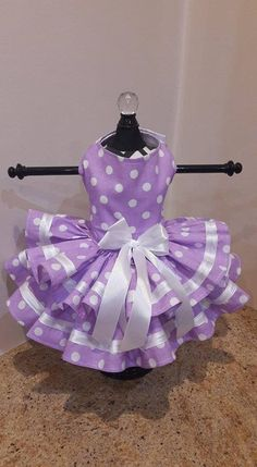 Dog Dress Designed and Made by Ninas Couture Closet - Made out of high quality cotton - The top is lined with cotton fabric so its soft for your babies - Its double skirted - D ring for easy leash attachment - Velcro closing around the neck and girth - Decorated with satin ribbon -