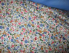 "Sku #:1550-2 45"" Cotton, Pretty Floral Print, Coral Pink, Copen Blue, Gold, Lt. BluePrice: $12.98per yard"