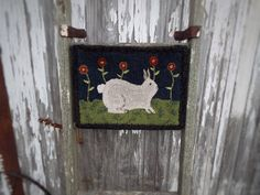 A personal favorite from my Etsy shop https://www.etsy.com/listing/514132490/primitive-hand-hooked-rug-baxter-the