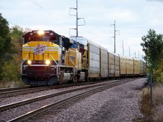 C&NW heritage unit westbound at Fairfax, IA.
