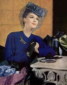 'Royal blue daywear elegance, 1946' -- Love the hat with veil and her gloves too