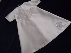 Angel gown with sequinned applique panels.